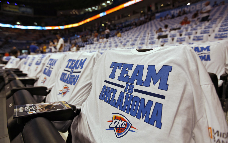 Photo - Thunder shirts fill the seats before Game 2 in the second round of the NBA playoffs between the Oklahoma City Thunder and the L.A. Lakers at Chesapeake Energy Arena on Tuesday,  May 15, 2012, in Oklahoma City, Oklahoma. Photo by Chris Landsberger, The Oklahoman