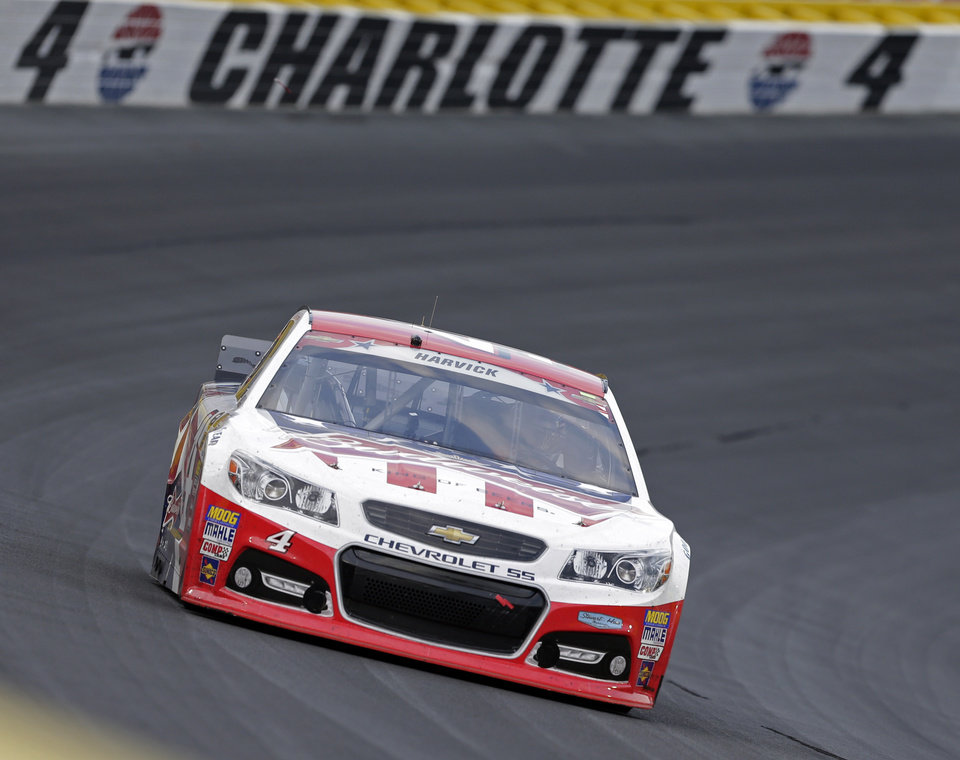 Photo - Kevin Harvick (4) drives out of Turn 4 during the NASCAR Sprint Cup series Coca-Cola 600 auto race at Charlotte Motor Speedway in Concord, N.C., Sunday, May 25, 2014. (AP Photo/Chuck Burton)