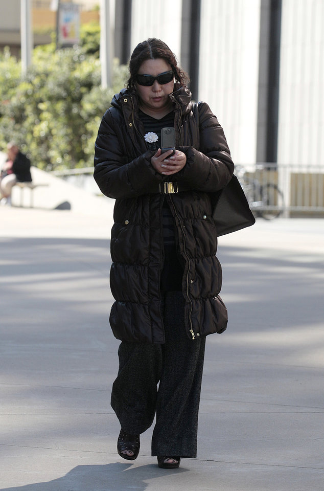 Photo - File - This March 8, 2012, file photo shows Christina Liew as she walks out of a federal courthouse in San Francisco. Liew's husband, chemical engineer Walter Liew, is facing more than 20 years in prison when he is sentenced Thursday, July 10, 2014, for a rare economic espionage conviction for selling technology for a white pigment to China. Christina Liew has pleaded not guilty to economic espionage charges and awaits trial. (AP Photo/Jeff Chiu, File)