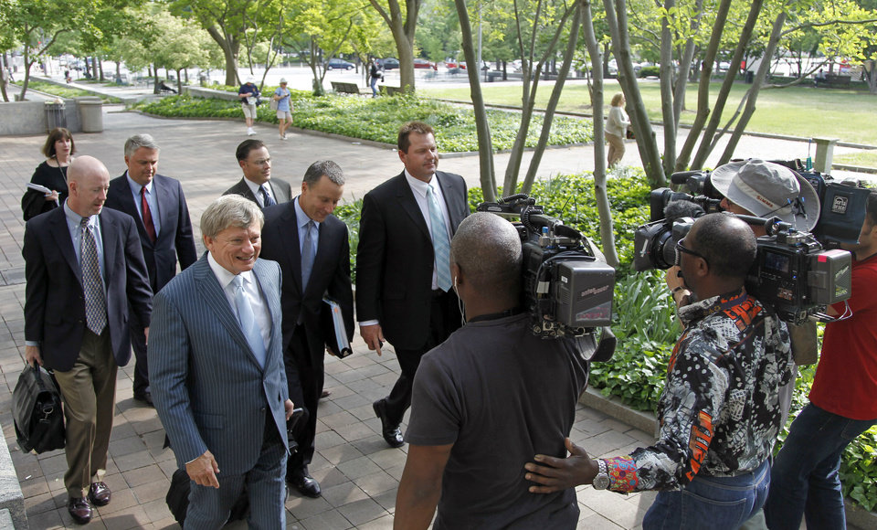 Former Major League Baseball pitcher Roger Clemens, right, leaves federal court, Tuesday, May 1, 2012 in Washington, as his retrial continues on charges of lying to Congress in 2008 when he said he had never used steroids of human growth hormone. (AP Photo/Haraz N. Ghanbari)