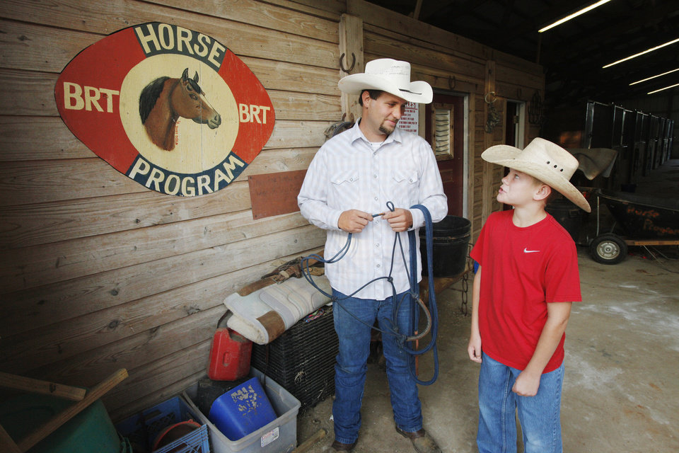 Justin Endecott, horse program director, and resident Alec Carpenter, age 12, in the horse barn at Boys Town Ranch in Edmond Wednesday, Aug. 8, 2012. Photo by Paul B. Southerland, The Oklahoman