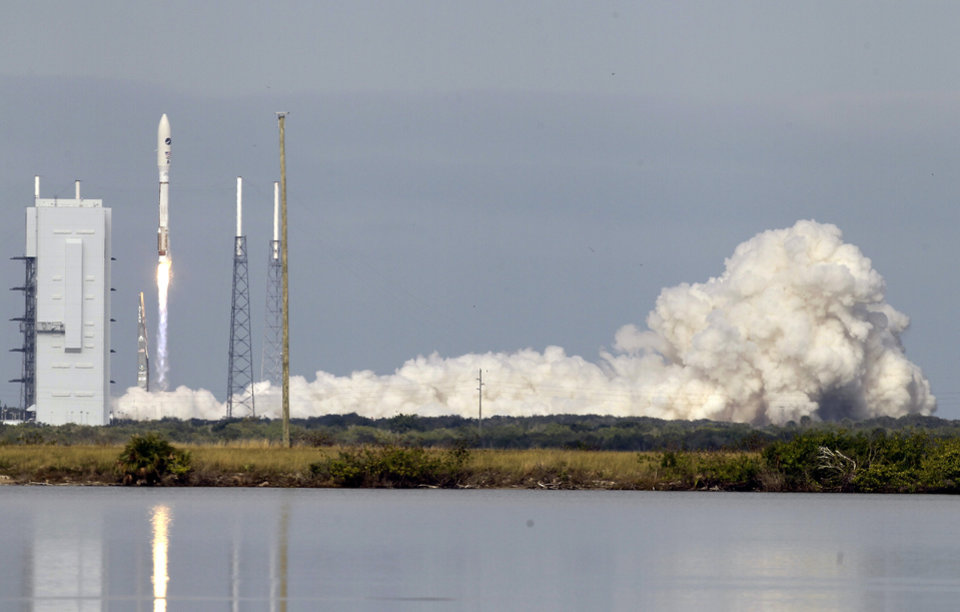 Photo - A United Launch Alliance Atlas V rocket, carrying an X-37B experimental robotic space plane, lifts off from launch complex 41 at the Cape Canaveral Air Force Station, Tuesday, Dec. 11, 2012, in Cape Canaveral, Fla. Air Force officials said the unmanned space plane, which resembles a miniature space shuttle, provides a way to test technologies in space.(AP Photo/John Raoux)