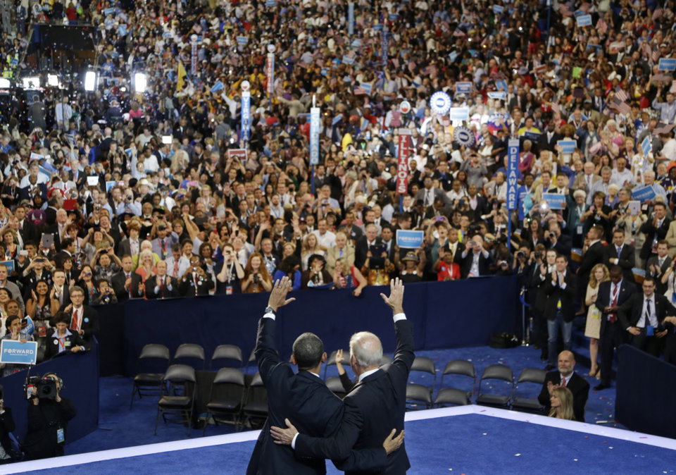 Photo -   President Barack Obama, left, and Vice President Joe Biden wave to delegates at the Democratic National Convention in Charlotte, N.C., on Thursday, Sept. 6, 2012. (AP Photo/Charlie Neibergall)