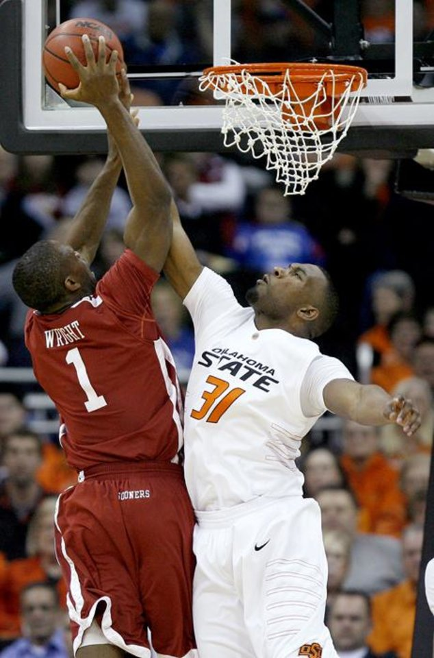 Photo -  OSU's Matt Pilgrim blocks the shot of OU's Ryan Wright in the first half of the college basketball game during the men's Big 12 Championship tournament at the Sprint Center on Wednesday, March 10, 2010, in Kansas City, Mo. Photo by Bryan Terry, The Oklahoman ORG XMIT: KOD