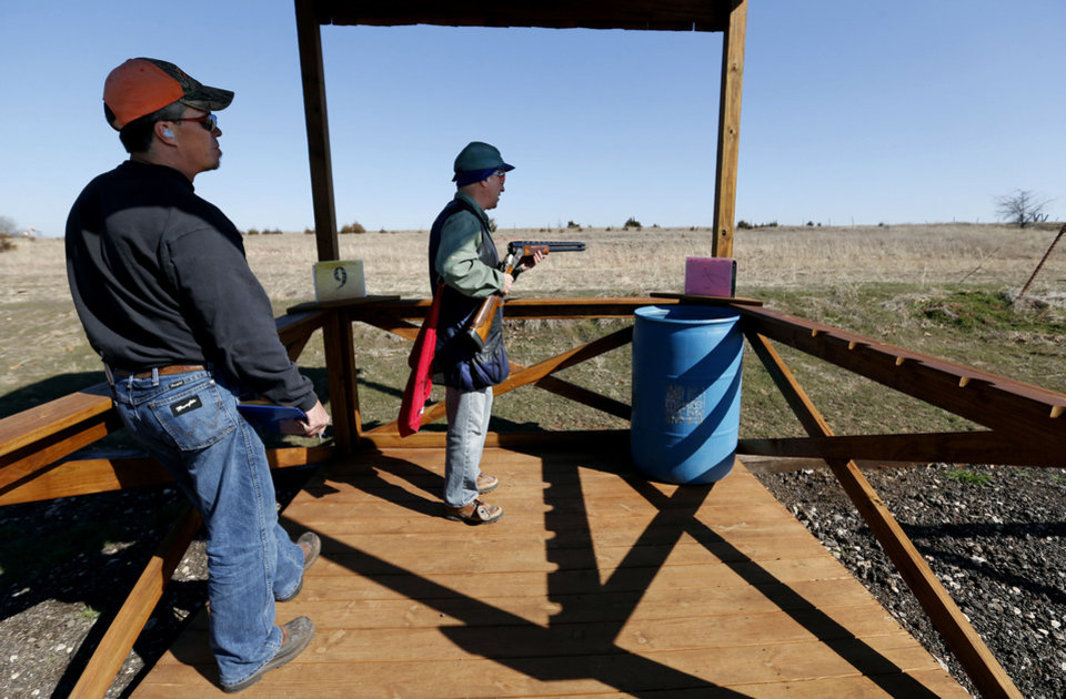 Tony Greenberg, Oklahoma City, right, prepares to shoot as John Russell scores at Quail Ridge Sporting Clays on Wednesday, Feb. 13, 2013 in Norman, Okla.   Photo by Steve Sisney, The Oklahoman