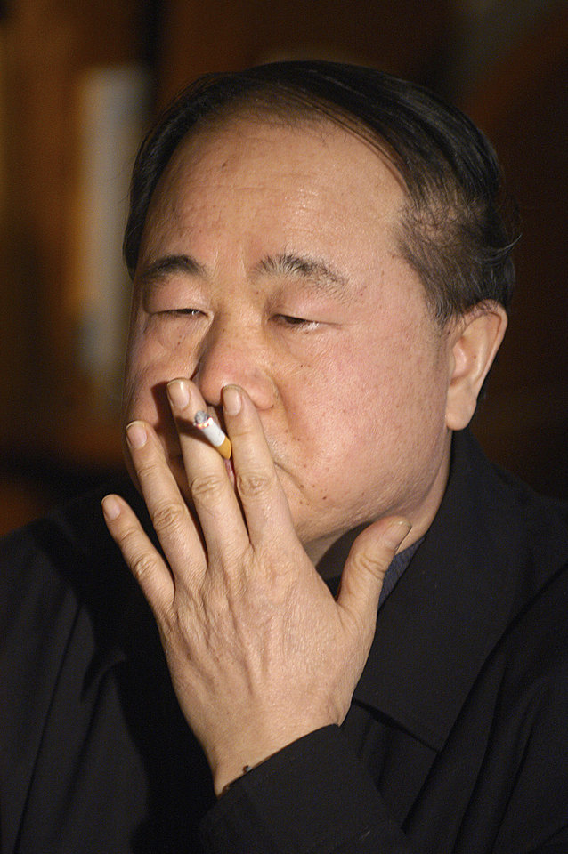 Photo -   In this photo taken Tuesday Dec. 27, 2005, Chinese writer Mo Yan smokes during an interview in Beijing, China. Mo won the Nobel Prize in literature on Thursday, Oct. 11, 2012. (AP Photo) CHINA OUT