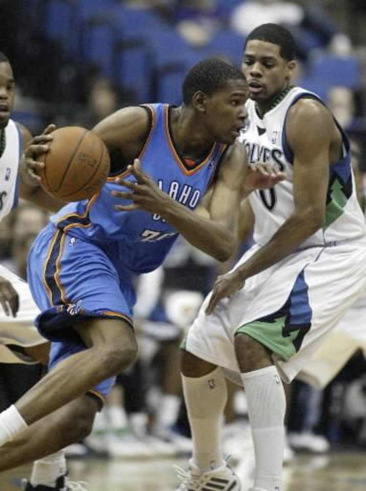 Oklahoma City Thunder forward  Kevin  Durant, left, drives against Minnesota Timberwolves forward Rodney Carney during the second half in an NBA basketball game, Sunday, March 22, 2009 in Minneapolis.  Durant had a game-high 30 points as the Thunder won 97-90. (AP Photo/Paul Battaglia)