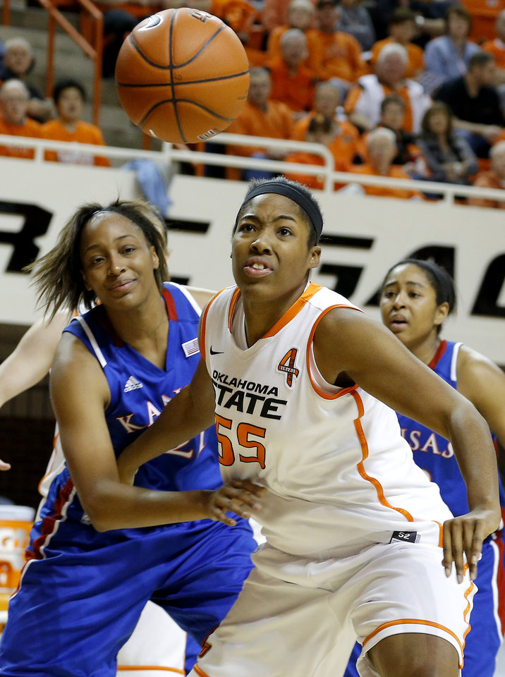 Photo - Oklahoma State's LaShawn Jones (55) and Kansas' Carolyn Davis (21) go for the ball during a women's college basketball game between Oklahoma State University (OSU) and Kansas at Gallagher-Iba Arena in Stillwater, Okla., Tuesday, Jan. 8, 2013. Photo by Bryan Terry, The Oklahoman