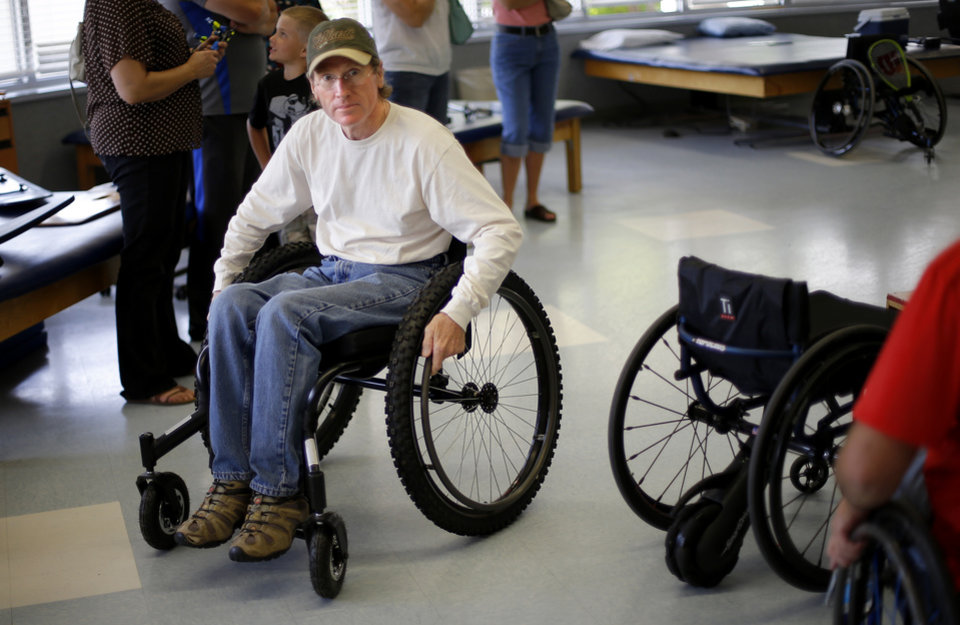 Photo -  Steve Scalzo tries out an off-road wheelchair at Jim Thorpe Rehabilitation Center in Oklahoma City. Photo by Bryan Terry, The Oklahoman   Bryan Terry -