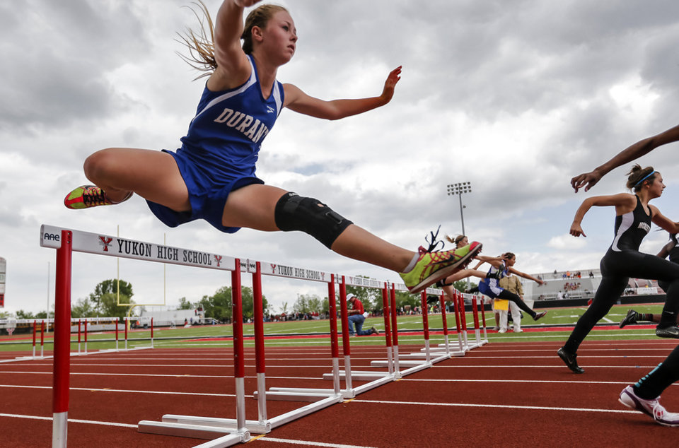 Durant's Katheryn Prentice runs in the 5A 100m hurdles during the class 5A and 6A track state championships at Yukon High School on on Friday, May 10, 2013, in Yukon, Okla.Photo by Chris Landsberger, The Oklahoman