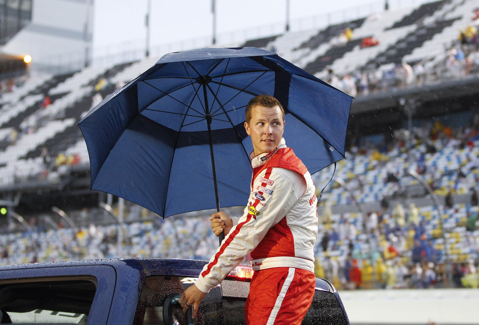 Photo - Trevor Bayne rides around the track during driver introductions before the NASCAR Sprint cup Series auto race at Daytona International Speedway in Daytona Beach, Fla., Saturday, July 5, 2014. (AP Photo/Terry Renna)