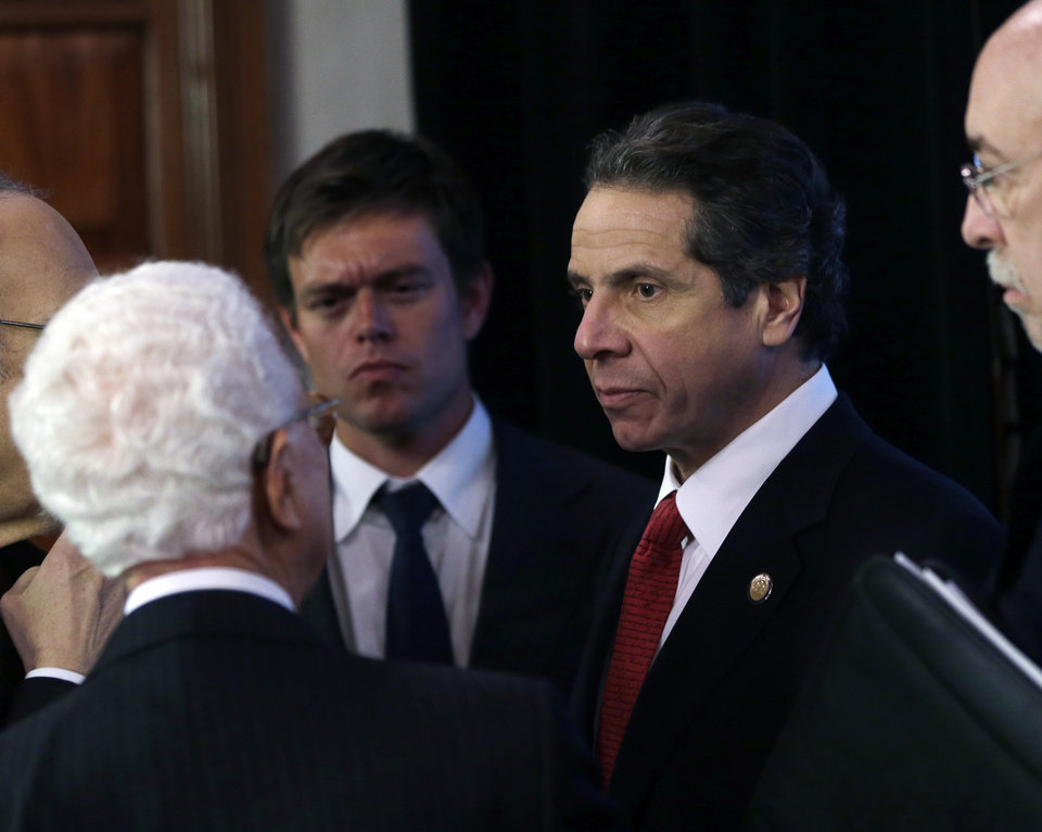 "New York Gov. Andrew Cuomo talks to NYS Responds and NYS Ready Commissions members following a meeting in the Red Room at the Capitol on Thursday, Jan. 3, 2013, in Albany, N.Y. A still angry Cuomo isn't ready to believe the Republican House leadership will finally vote on Sandy relief aid. Instead, he's telling them: ""Show me the money."" (AP Photo/Mike Groll)"