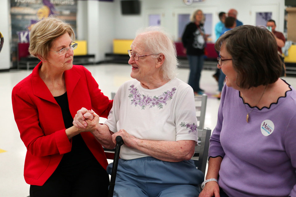 Photo - U.S. Senator and NWC Alum, Class of '66 Elizabeth Warren, poses with Katherine Jordan, 93, and Julia Jordan-Gillett after the AFT education rally at Northwest Classen High School, Saturday, September, 22, 2018.  Photo by Doug Hoke, The Oklahoman