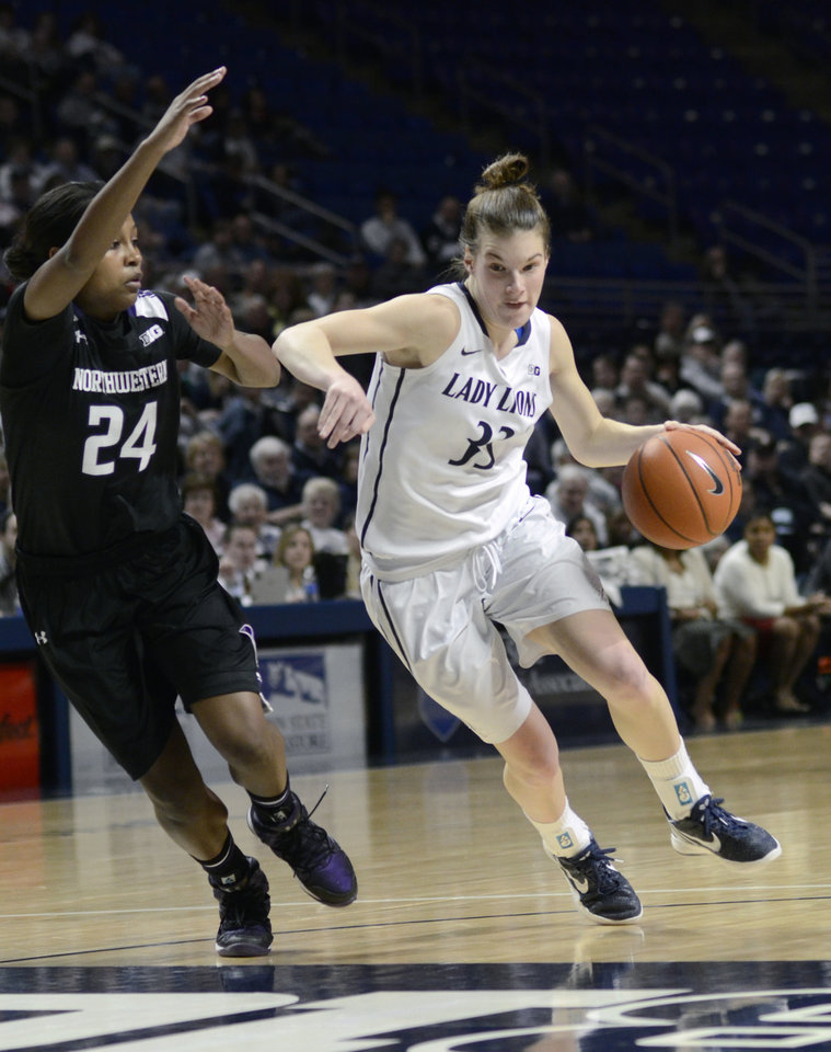Photo - Penn State's Maggie Lucas (33) moves into the paint around Northwestern's Christen Inman (24) during the first half of an NCAA basketball game in State College, Pa. , Thursday, Feb. 20, 2014. (AP Photo/Ralph Wilson)