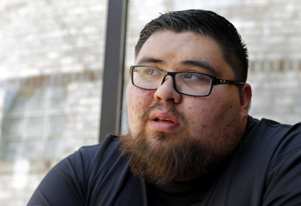Photo -  Joshua Holley, lost his brother, Jeffrey, to suicide in 2015. [Photo by Steve Sisney, The Oklahoman]