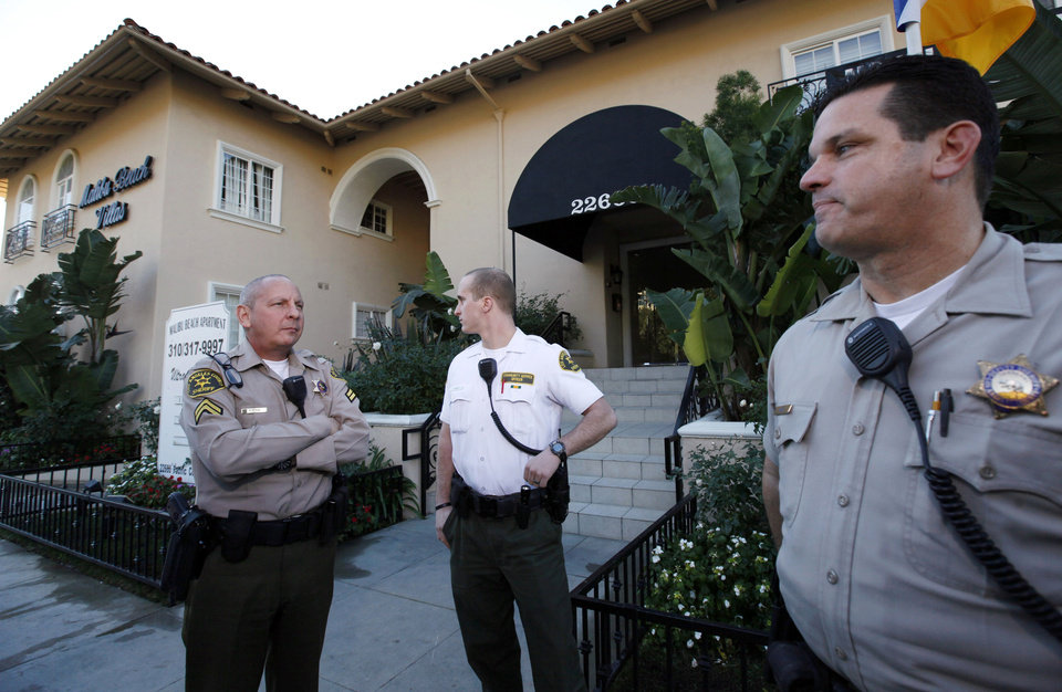 Photo - Los Angeles County Sheriff's officers stand outside an apartment building where Scott Sterling,  the son of the  Los Angeles Clippers owner Donald Sterling, lived in Malibu on Wednesday, Jan.2,2012. Scott Sterling was found dead of an apparent drug overdose at his Malibu home, authorities said Wednesday. (AP Photo/Nick Ut)