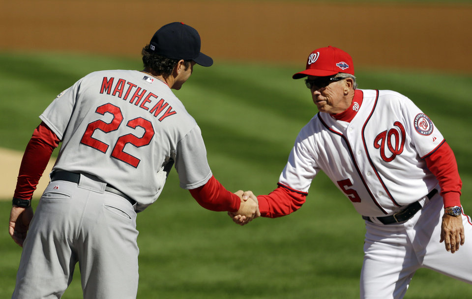 Photo -   St. Louis Cardinals manager Mike Matheny, left, and Washington Nationals manager Davey Johnson shake hands before Game 3 of the National League division baseball series on Wednesday, Oct. 10, 2012, in Washington. (AP Photo/Pablo Martinez Monsivais)