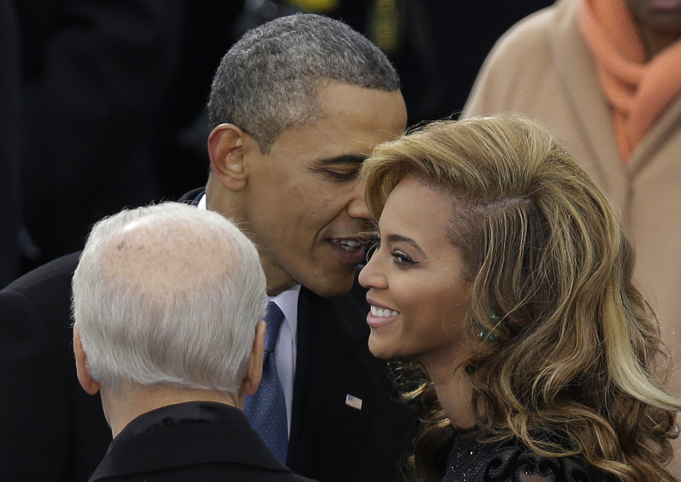 President Barack Obama talks to Beyonce before she sings the National Anthem at his ceremonial swearing-in at the U.S. Capitol during the 57th Presidential Inauguration in Washington, Monday, Jan. 21, 2013. (AP Photo/Evan Vucci)  ORG XMIT: CAP352