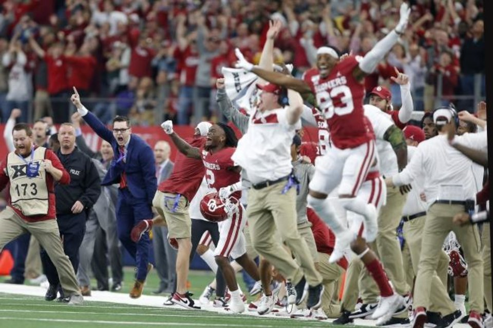 Photo -  Oklahoma's CeeDee Lamb (2) and the Sooners celebrate their 30-23 overtime win against Baylor for the Big 12 title Saturday at AT&T Stadium in Arlington, Texas. [Bryan Terry/The Oklahoman]