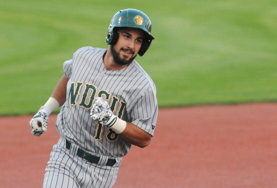 Photo - North Dakota State's Kyle Kleinendorst rounds third after hitting a solo home run against Oregon State during an NCAA college baseball tournament regional game in Corvallis, Ore., Friday, May 30, 2014. (AP Photo/Mark Ylen)