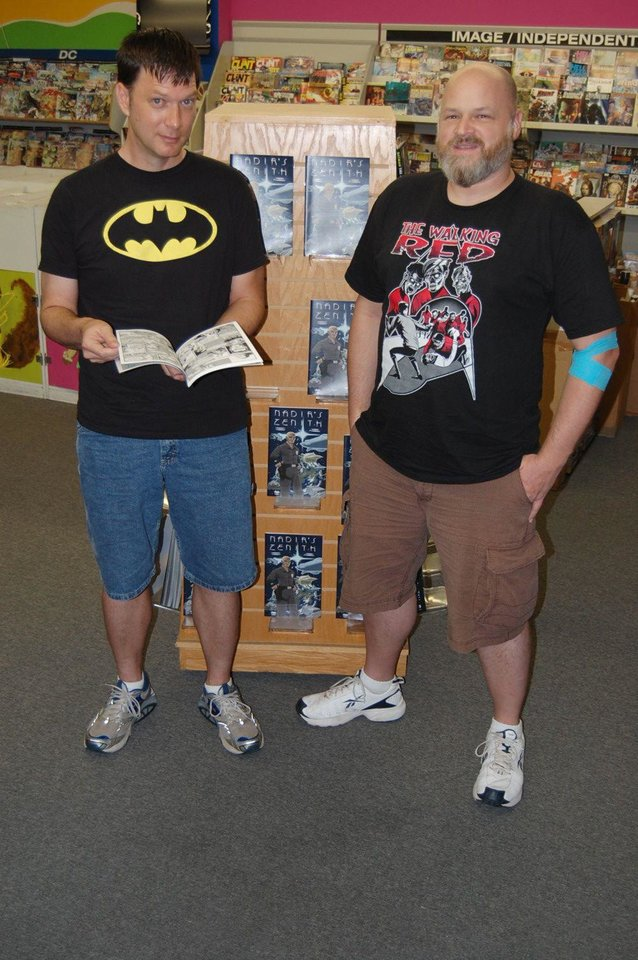 Photo - Writer Jackson Compton, left, and artist Jerry Bennett pose at a local comic-book store.  Photo by Annette Price, for The Oklahoman
