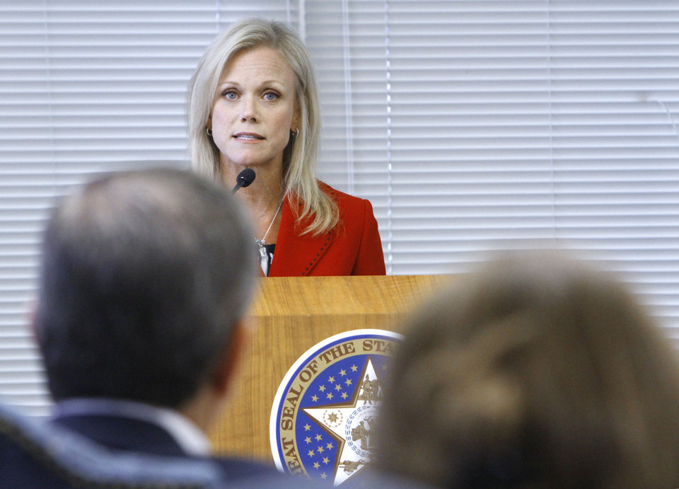 Photo - Broken Arrow Chief Academia Officer Janet Dunlop addresses the Board of Education deciding to grant high school diplomas to several Oklahoma students who failed state-mandated end-of-instuction exams, Tuesday, June 5, 2012.  Photo By David McDaniel/The Oklahoman