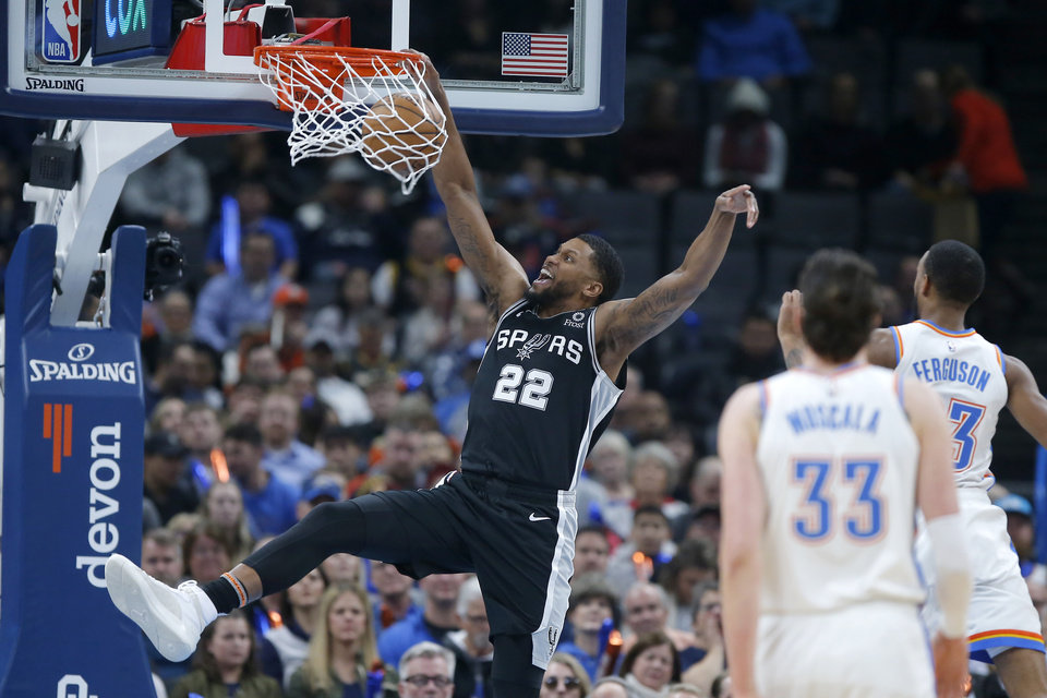 Photo - San Antonio's Rudy Gay (22) dunks the ball during an NBA basketball game between the Oklahoma City Thunder and the San Antonio Spurs at Chesapeake Energy Arena in Oklahoma City, Tuesday, Feb. 11, 2020. [Bryan Terry/The Oklahoman]