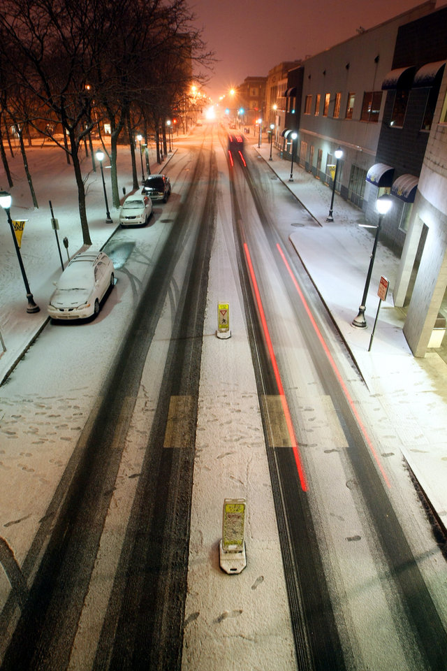Photo - Automobiles travel along South Main Street in Wilkes-Barre, Pa., Friday, Feb. 8, 2013, as it snows in this time lapse photo.  (AP Photo/The Citizens' Voice, Kristen Mullen) MANDATORY CREDIT