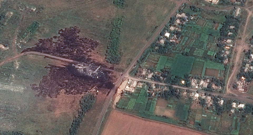 Photo - In this photo provided and dated Sunday, July 20, 2014 by Airbus DS/AllSource Analysis, a satellite image shows the primary crash site, at left, of Malaysia Airlines Flight 17 located near Hrabove, eastern Ukraine. Four days after Flight 17 was shot out of the sky, international investigators still have had only limited access to the crash site, hindered by the pro-Russia fighters who control the verdant territory in eastern Ukraine. (AP Photo/Airbus DS/AllSource Analysis) MANDATORY CREDIT