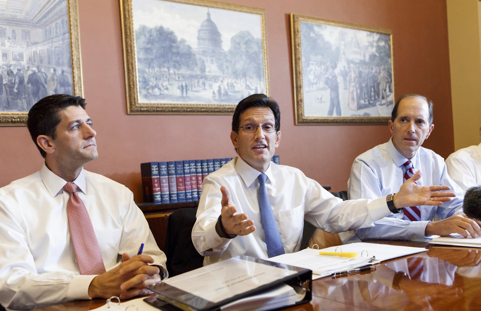Photo - FILE - In this Oct. 1, 2013 file photo, House Majority Leader Eric Cantor, R-Va., center, flanked by House Budget Committee Chairman Rep. Paul Ryan, R-Wis., and House Ways and Means Committee Chairman Rep. Dave Camp , R-Mich., speaks on Capitol Hill in Washington. House Republican leaders took a small step on Friday toward pulling together a viable alternative to President Barack Obama's four-year-old health care law. On Friday, Cantor met privately Ryan, Camp Rep. John Kline, R-Minn. and Rep. Cathy McMorris Rodgers, R-Wash. to discuss a way forward.  (AP Photo/J. Scott Applewhite, File)