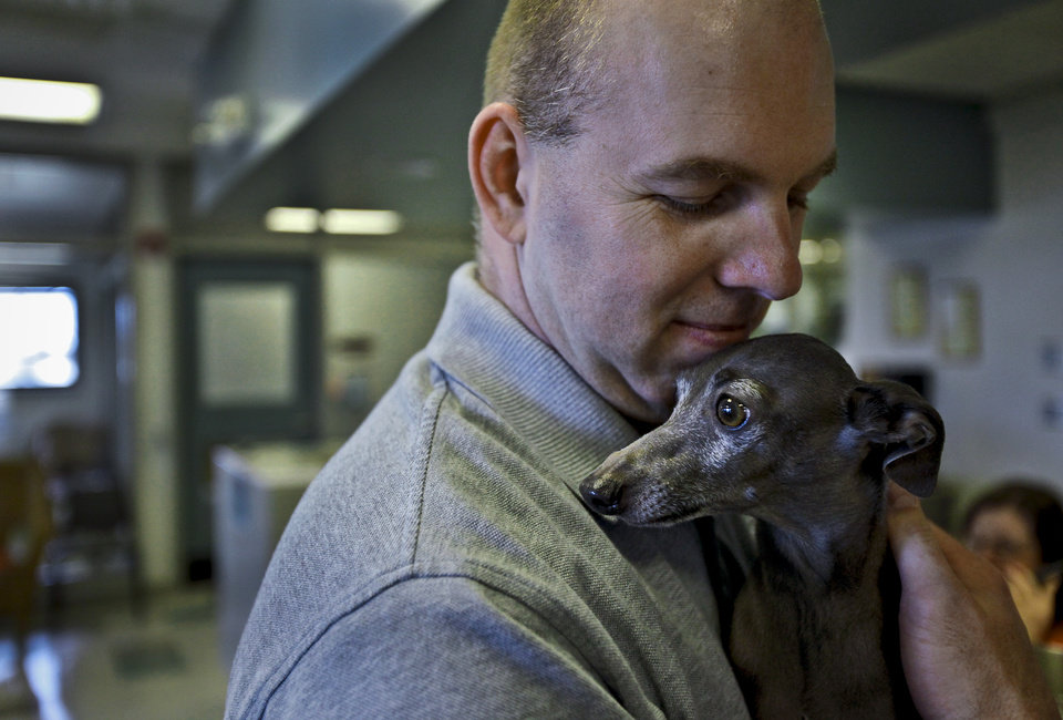 Oklahoma City Animal Shelter supervisor Edwin Kirk holds an Italian greyhound to  that was rescued from the cold by Errol Menk on Thursday, Jan. 20, 2011, in Oklahoma City, Okla. Shelters see their animal population rise as they take in more animals due to cruelty complaints during the harsh winter weather.   Photo by Chris Landsberger, The Oklahoman