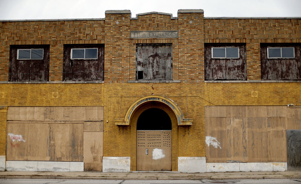 Photo - The Film Exchange Building may soon be torn down unless preservationists succeed in convincing the city to incorporate the building as part of the new Core to Shore park.  SARAH PHIPPS