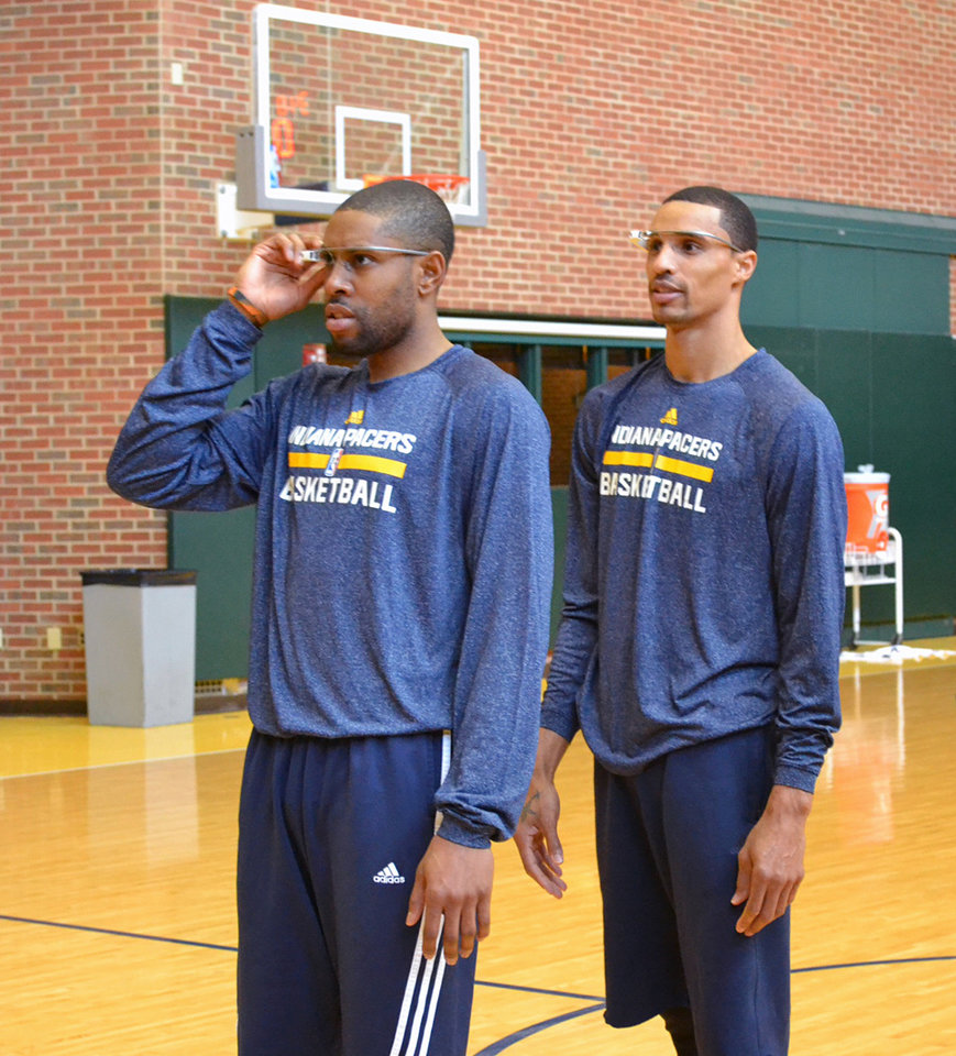 Photo -  In this March 25 photo provided by Pacers.com, Indiana Pacers basketball players C. J. Watson, left, and George Hill wear Google glasses during practice at Bankers Life Fieldhouse in Indianapolis. Google Glass is slowly becoming more common in sports as teams and broadcasters try to bring fans closer to the action. AP Photo   Celeste ballou -  AP