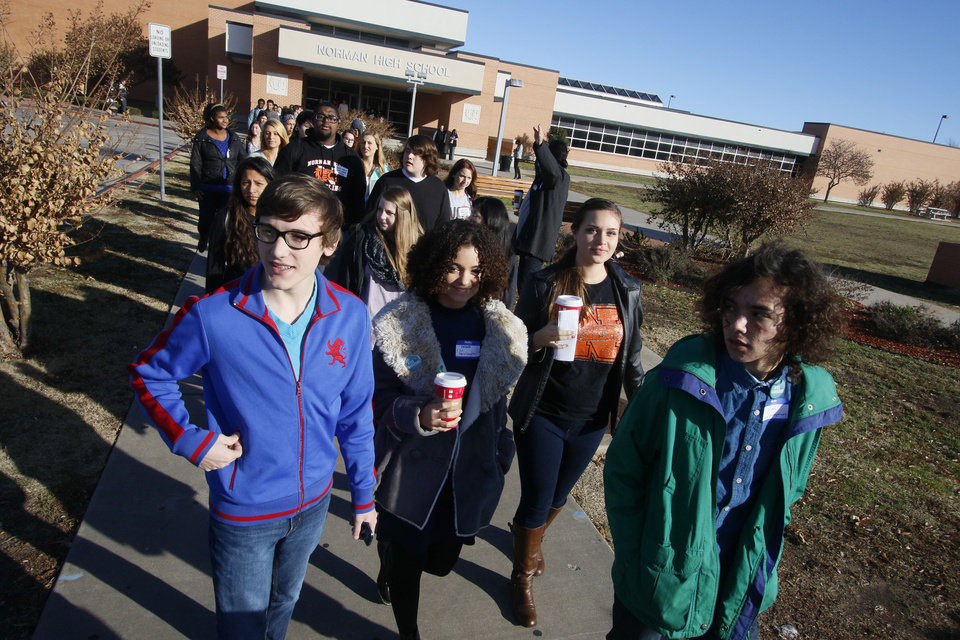 Photo - Norman High School students participate in a student-planned walkout to protest bullying and the treatment of sexual assault victims at Norman High School in Norman, OK, Monday, November 24, 2014,  Photo by Paul Hellstern, The Oklahoman