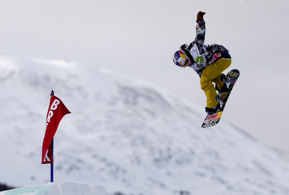 Sarka Pancochova, of the Czech Republic, flies off a jump on her second run during the women's slopestyle snowboarding final at the Dew Tour iON Mountain Championships, Friday, Dec. 13, 2013, in Breckenridge, Colo. (AP Photo/Julie Jacobson)