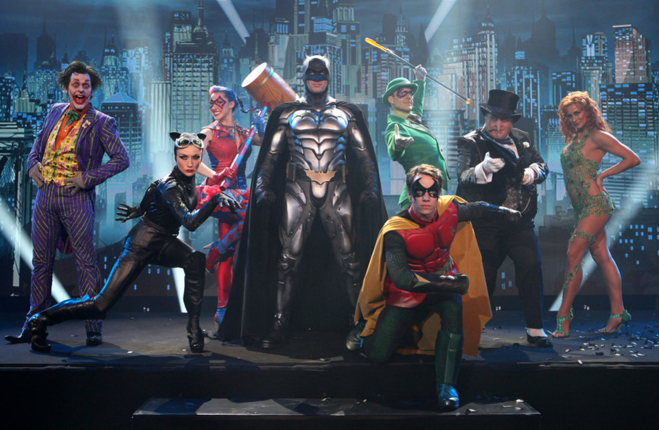 Nick Court, who plays Batman, center, Michael Pickering who plays Robin, foreground right,  Garry Lake,  who plays the Joker, left, perform on stage to launch the Batman Live Tour in central London, Tuesday 12 April 2010, which tours arenas across the UK and Europe beginning in Summer 2011, and arrives in North America in August 2012. Combining acrobatics, stunt work and illusions, the adventures of Batman and Robin are brought to life on stage for the first time in the characters history.(AP Photo/Joel Ryan)