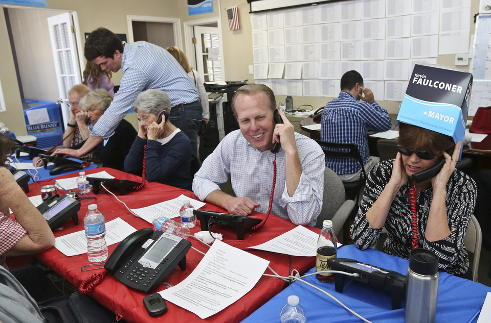 Photo - San Diego mayoral candidate Kevin Faulconer sits among  his volunteers calling voters Tuesday, Feb. 11, 2014, in San Diego. Faulconer faces fellow city commissioner David Alvarez in the race to replace disgraced mayor Bob Filner.  (AP Photo/Lenny Ignelzi)