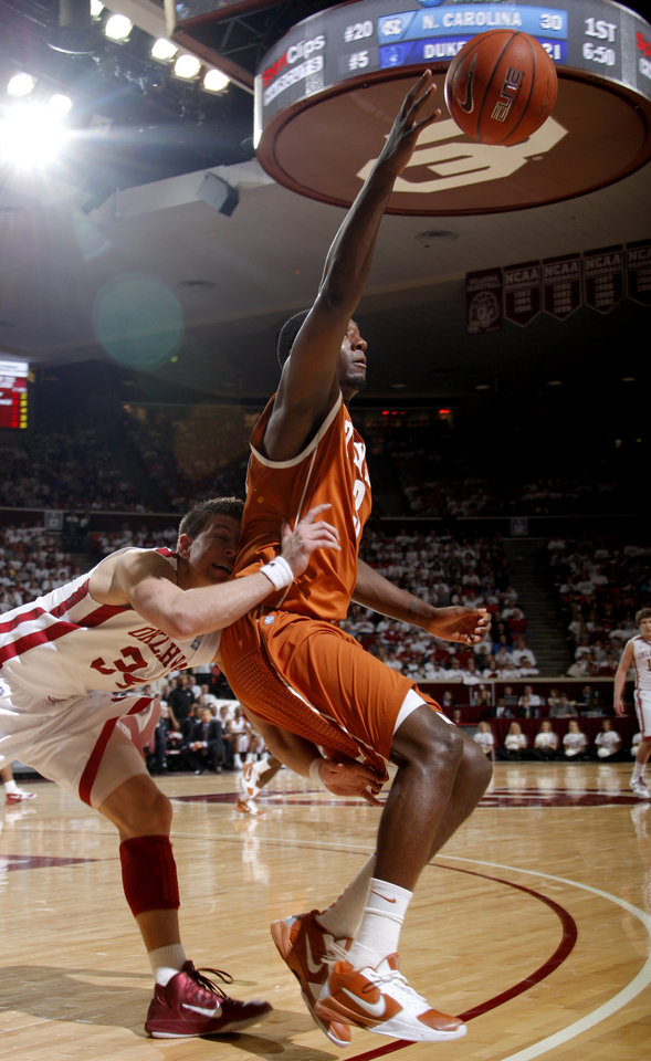 Photo - during the NCAA college basketball Oklahoma's Cade Davis (34) runs into Texas' Jordan Hamilton game between the University of Oklahoma Sooners and Texas Longhorns at Lloyd Noble Center in Norman, Okla., Wednesday, Feb. 9, 2011. Photo by Bryan Terry, The Oklahoman