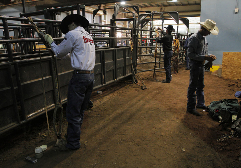 Cowboys get ready for competition before the Ram National Circuit Finals Rodeo Championship in Oklahoma City, Sunday, April 1, 2012.  Photo by Garett Fisbeck, For The Oklahoman