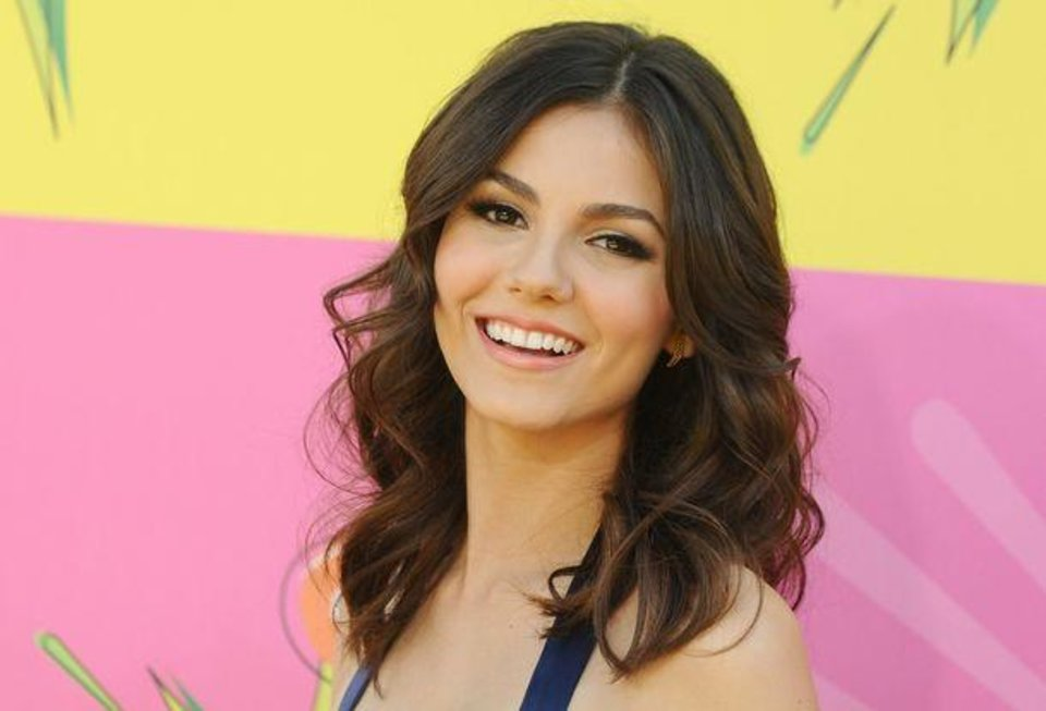Photo -  Victoria Justice arrives at the 26th annual Nickelodeon's Kids' Choice Awards on Saturday, March 23, 2013, in Los Angeles. (AP)