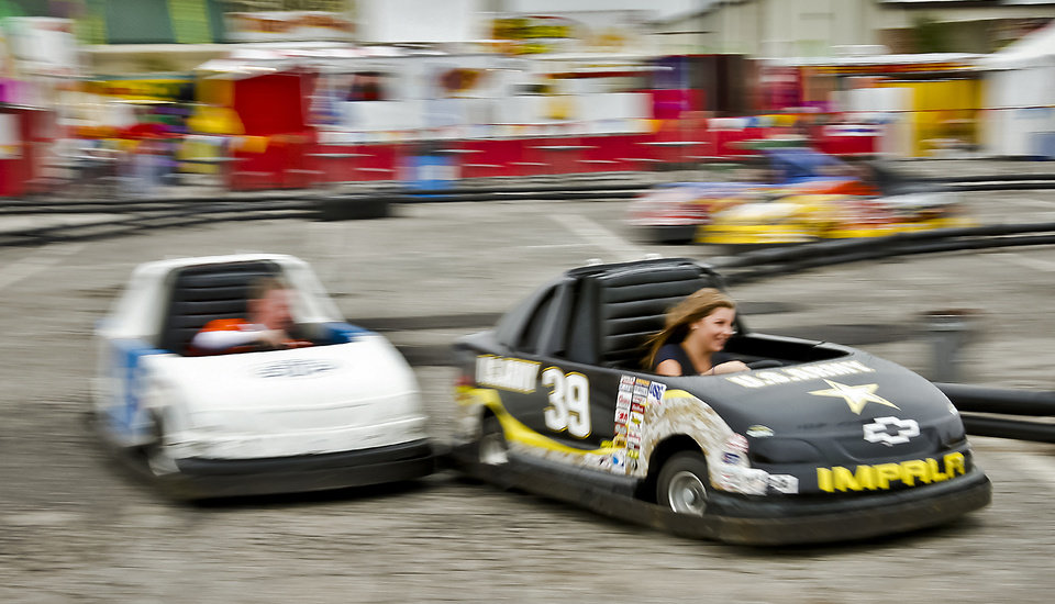 Photo - Fair visitors race go carts at the Oklahoma State Fair at State Fair Park on Friday, Sept. 14, 2012, in Oklahoma City, Oklahoma.  Photo by Chris Landsberger, The Oklahoman