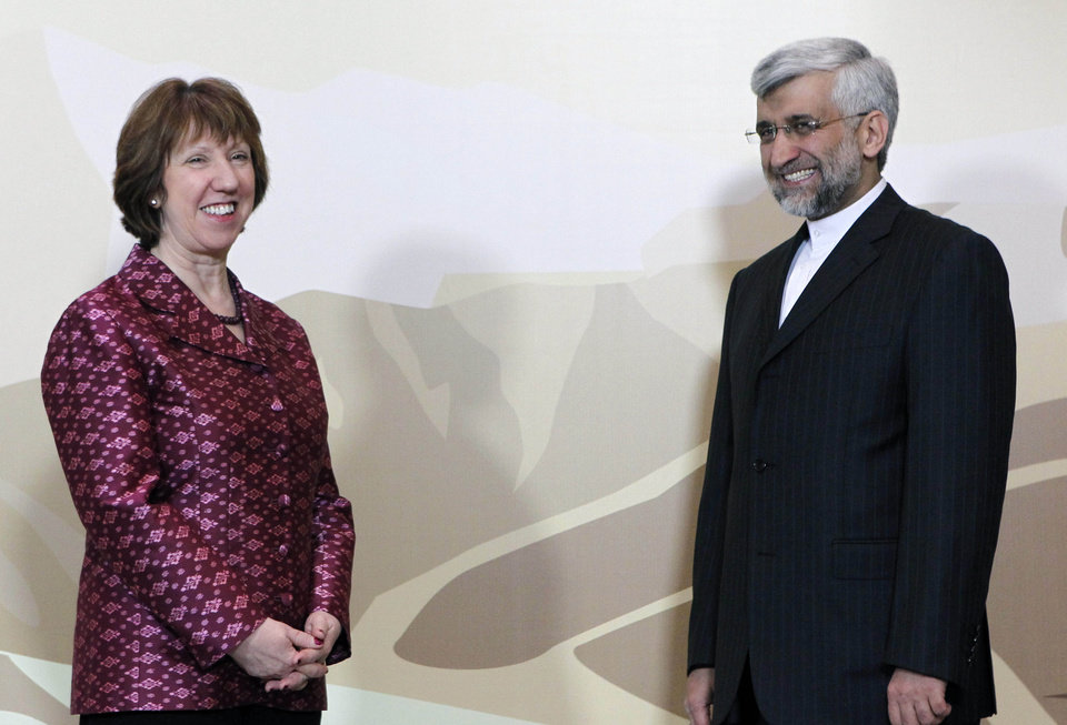EU foreign policy chief Catherine Ashton, left, and Secretary of Iran's Supreme National Security Council, Saeed Jalili pose for photos at a start of high-level talks between world powers and Iranian officials in Almaty, Kazakhstan on Friday, April 5, 2013. (AP Photo/Shamil Zhumatov, Pool)