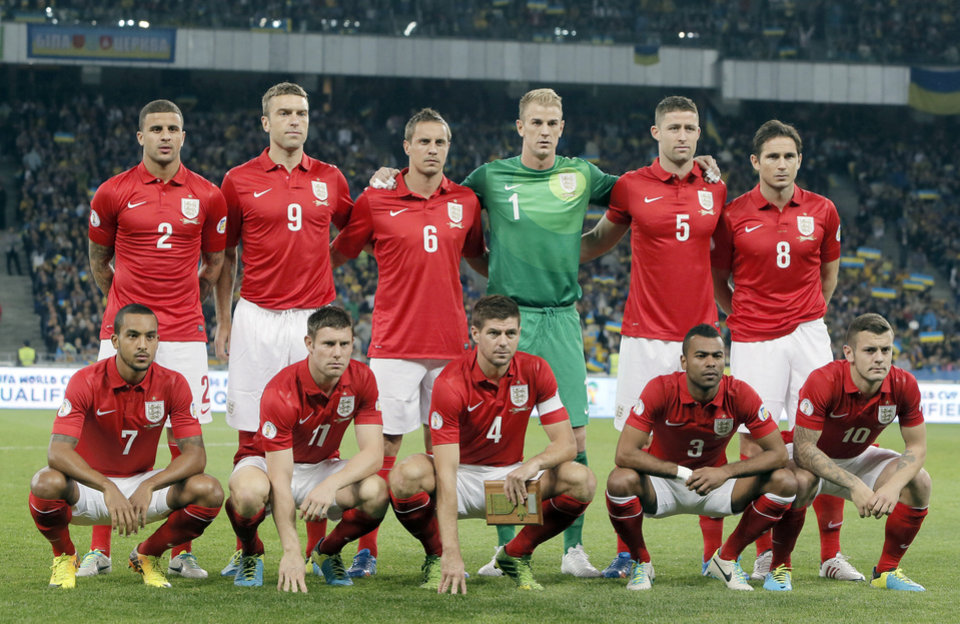 Photo - FILE - In this Sept. 10, 2013 file photo, England national soccer team poses prior to the World Cup qualifier group H soccer match between Ukraine and England at the Olympiyskiy national stadium in Kiev, Ukraine. Background from left: Kyle Walker, Rickie Lambert, Phil Jagielka, Joe Hart, Gary Cahill and Frank Lampard. Foreground from left: Theo Walcott, James Milner, Steven Gerrard, Ashley Cole and Jack Wilshere. The draw for the 2014 World Cup finals takes place Friday Dec. 6, 2013 near Salvador, Brazil. The 32 teams will be drawn into eight groups of four. The top two in each group will progress to the knockout stages. Twelve stadiums in twelve cities will host matches. (AP Photo/Efrem Lukatsky, File)