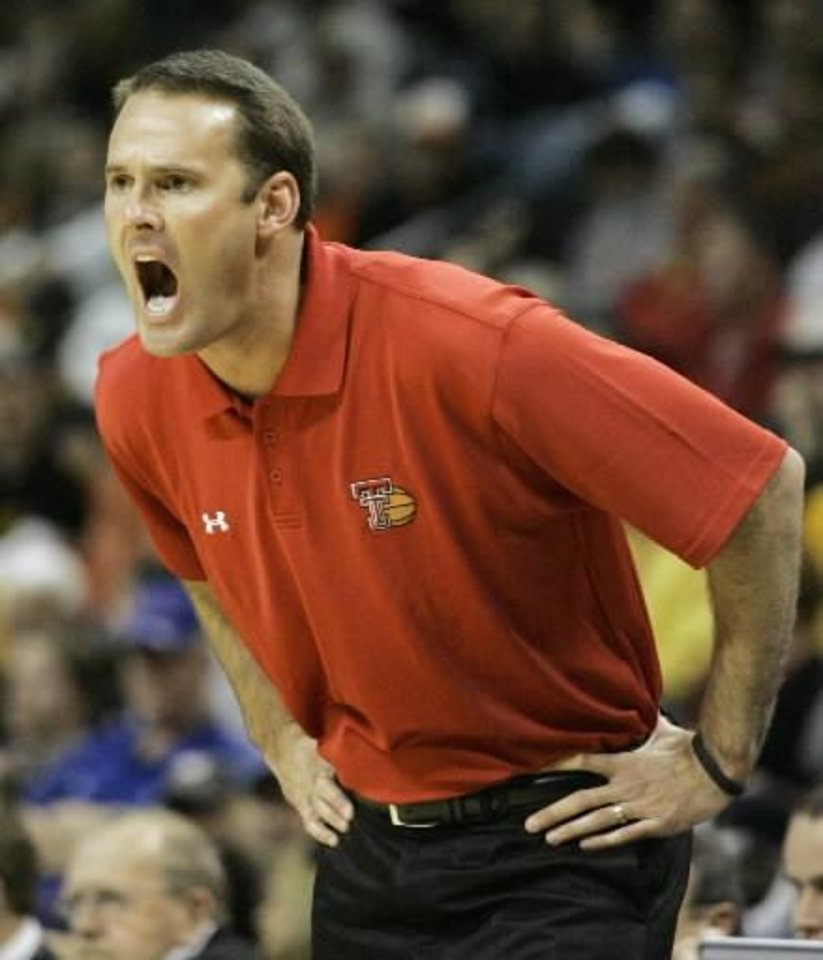 Photo - Texas Tech coach  Pat  Knight reacts in the first half in a game against Missouri during an NCAA college basketball game at the Big 12 Conference men's tournament in Oklahoma City, Thursday, March 12, 2009. (AP Photo/Donna McWilliam)