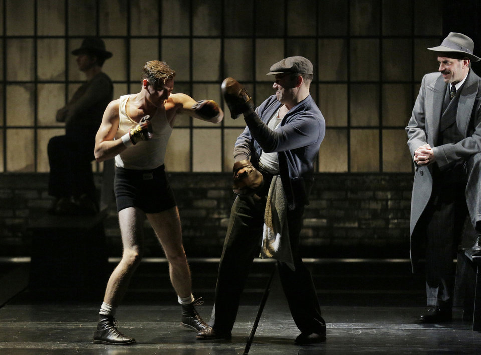 This theater image released by Lincoln Center Theater shows, from left, Seth Numrich, Danny Burstein and Danny Mastrogiorgio in