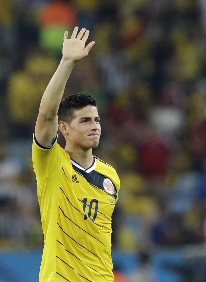 Photo - Colombia's James Rodriguez waves to supporters following Colombia's 2-0 victory over Uruguay during the World Cup round of 16 soccer match between Colombia and Uruguay at the Maracana Stadium in Rio de Janeiro, Brazil, Saturday, June 28, 2014.  (AP Photo/Matt Dunham)