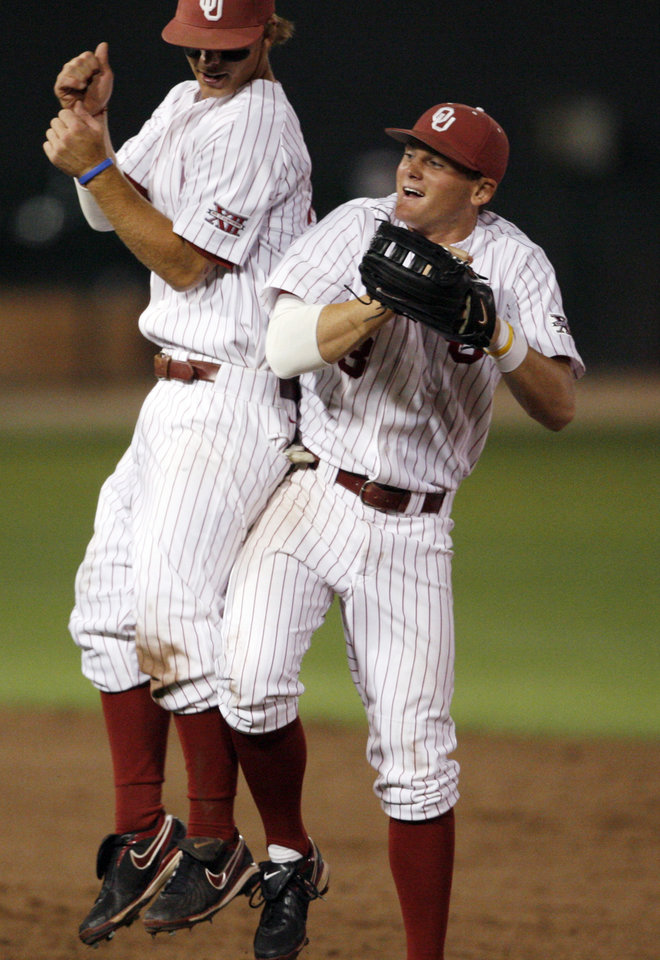 Photo - Garrett Buchele (left) and Casey Johnson celebrate as the University of Oklahoma defeats Wichita State 5-4 at L. Dale Mitchell Park in the NCAA Regional baseball tournament in Norman, Okla. on Friday, May 29, 2009. 