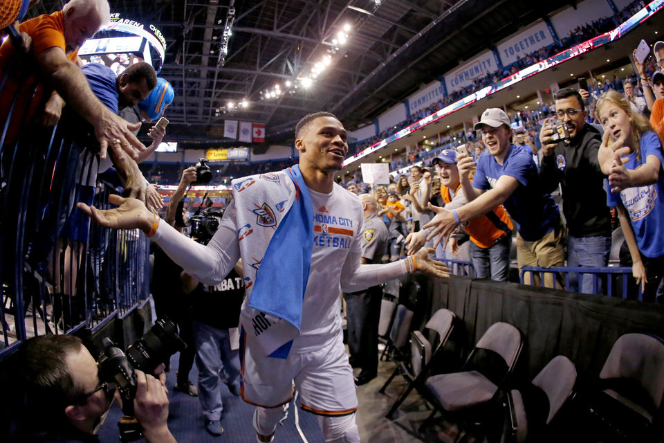 Photo - Oklahoma City's Russell Westbrook (0) celebrates with fans after an NBA basketball game between the Oklahoma City Thunder and the Milwaukee Bucks at Chesapeake Energy Arena in Oklahoma City, Tuesday, April 4, 2017. Photo by Bryan Terry, The Oklahoman