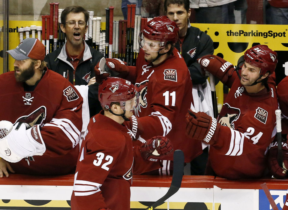 Phoenix Coyotes\' Nick Johnson (32) celebrates his goal against the Dallas Stars with teammates Martin Hanzal (11), of the Czech Republic, Kyle Chipchura (24) and Jason LaBarbera, left, during the second period in an NHL hockey game Saturday, Feb. 2, 2013, in Glendale, Ariz.(AP Photo/Ross D. Franklin)