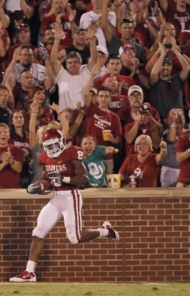 Sooner fans celebrate after a touchdown by Oklahoma's Dominique Whaley (8) during the college football game between the University of Oklahoma Sooners ( OU) and the Tulsa University Hurricanes (TU) at the Gaylord Family-Memorial Stadium on Saturday, Sept. 3, 2011, in Norman, Okla. Photo by Chris Landsberger, The Oklahoman ORG XMIT: KOD